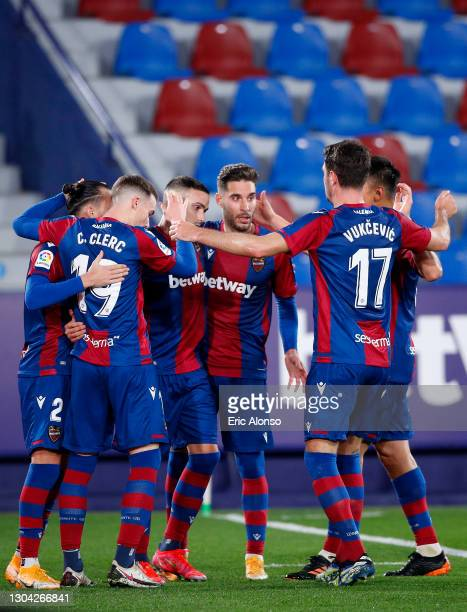 Roger of Levante UD is congratulated after scoring from the penalty spot during the La Liga Santander match between Levante UD and Athletic Club at...