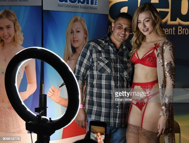 Roger Pereida of California poses for photos with adult film actress Alexa Grace at the Adult Entertainment Broadcast Network booth at the 2018 AVN...