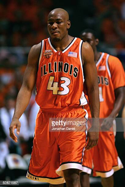 Roger Powell Jr of Illinois Fighting Illini grabs the rebound during the game against the Iowa Hawkeyes on January 20, 2005 at the Assembly Hall at...