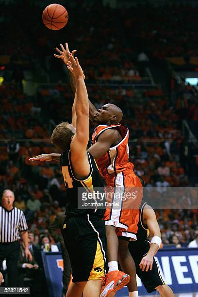 Roger Powell Jr of the Illinois Fighting Illini lays up a shot against Greg Brunner of the Iowa Hawkeyes during the game on January 20, 2005 at the...