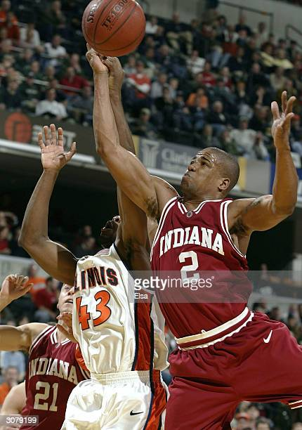 Roger Powell of Illinois and A.J. Moye of Indiana fight for the rebound during the Big Ten Tournament on March 12, 2004 at the Conseco Field House in...