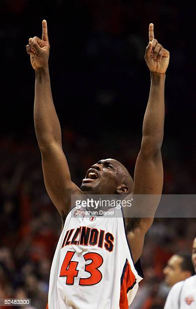 Roger Powell of the Illinois Fighting Illini celebrates after victory over the Arizona Wildcats in the Chicago Regional Final in the NCAA Division I...