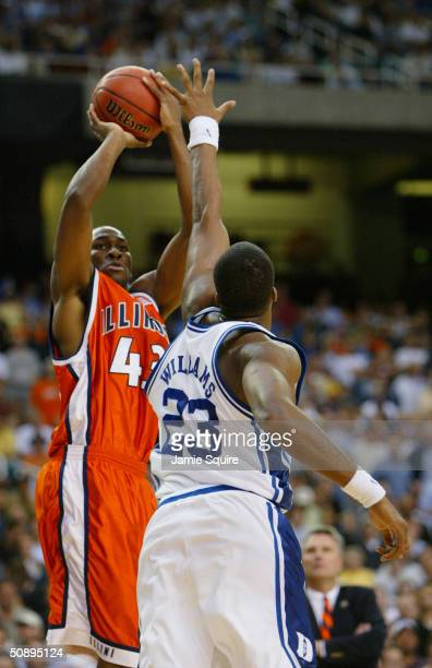 Roger Powell of the Illinois Fighting Illini shoots over Shelden Williams of the Duke Blue Devils during the Sweet 16 game of the NCAA Division I...