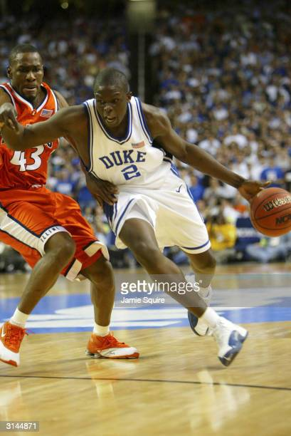 Roger Powell of the Illinois Fighting Illini watches as Luol Deng of the Duke Blue Devils from the United Kingdom drives to the basket during the...