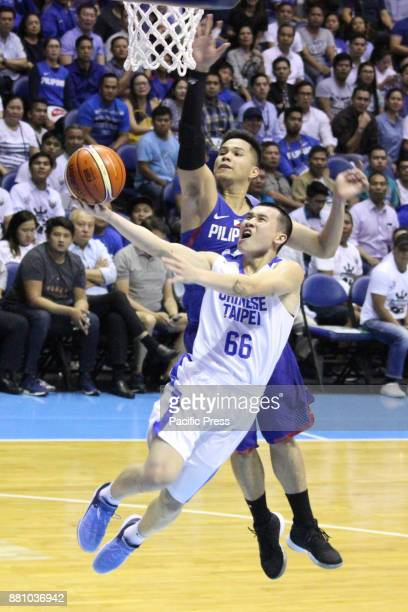 Roger Ray Pogoy of the Philippines tries to block a layup attempt by KaiYan Lee of Chinese Taipei during their FIBA World Cup Qualifying Match Gilas...