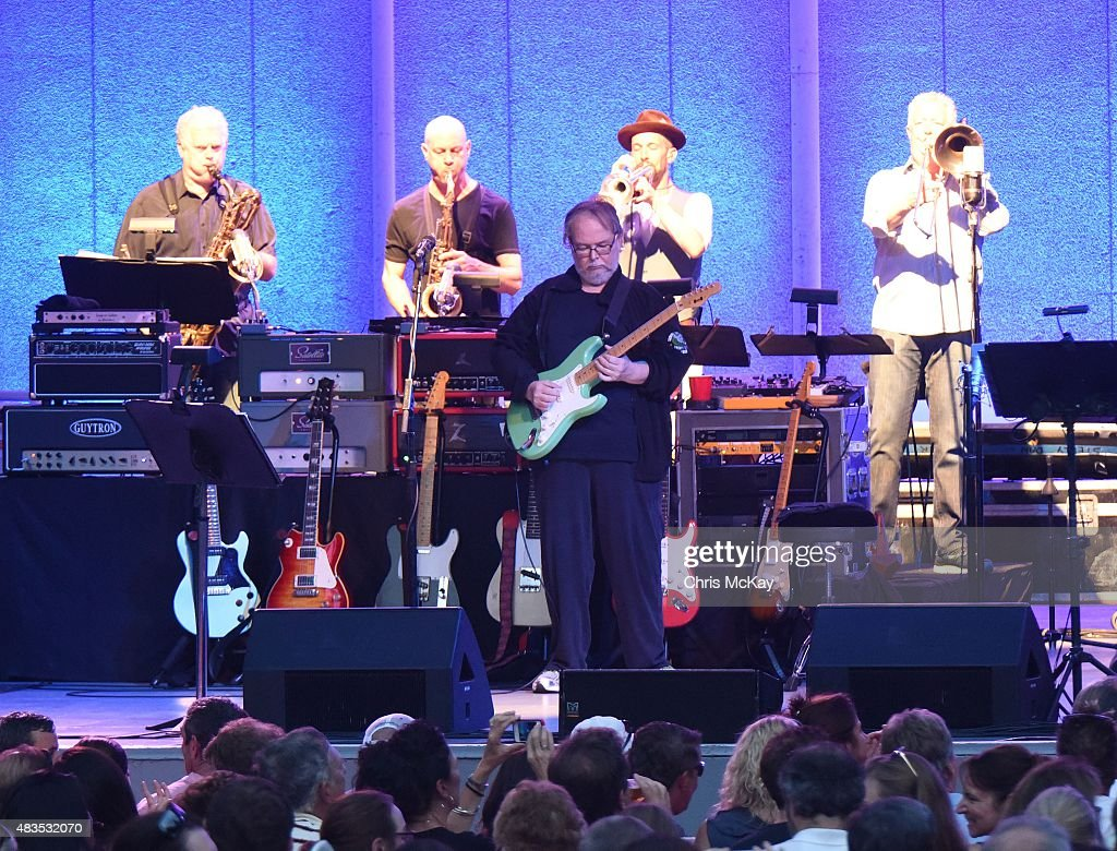 Roger Rosenberg, Walt Weiskopf, Walter Becker, Michael Leonhart, and Jim Pugh of Steely Dan perform at Chastain Park Amphitheater on August 9, 2015 in Atlanta, Georgia.