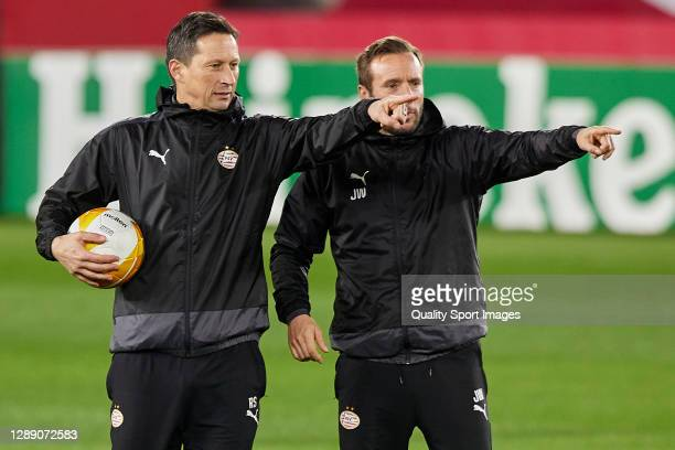 Roger Schmidt, manager of PSV Eindhoven and assistant-coach Lars Kornetka point during training session ahead of the UEFA Europa League Group E stage...