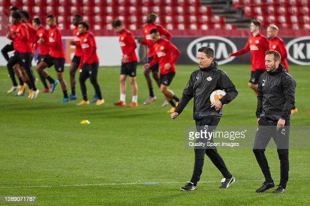 Roger Schmidt, manager of PSV Eindhoven and assistent-coach Lars Kornetka look on during training session ahead of the UEFA Europa League Group E...