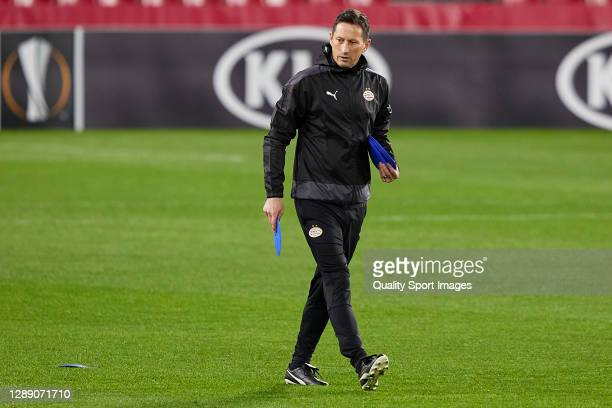 Roger Schmidt, manager of PSV Eindhoven places cones during training session ahead of the UEFA Europa League Group E stage match between PSV...