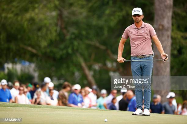 Roger Sloan of Canada looks on from the 18th green during the final round of the Wyndham Championship at Sedgefield Country Club on August 15, 2021...