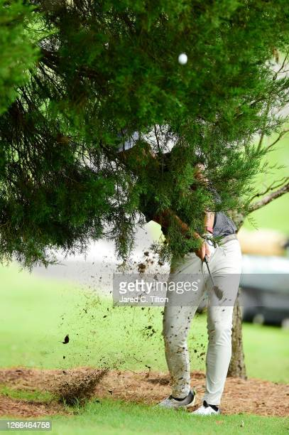 Roger Sloan of Canada plays a shot through the trees on the ninth hole during the third round of the Wyndham Championship at Sedgefield Country Club...