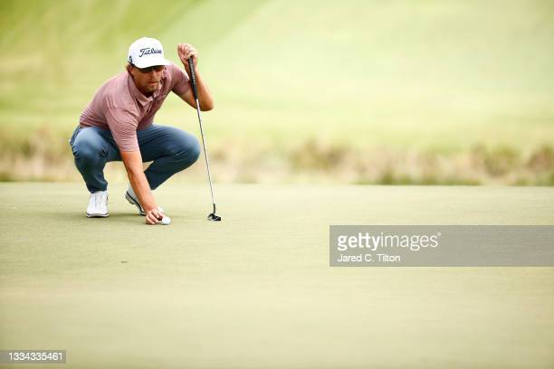 Roger Sloan of Canada prepares to putt on the 18th green during the final round of the Wyndham Championship at Sedgefield Country Club on August 15,...
