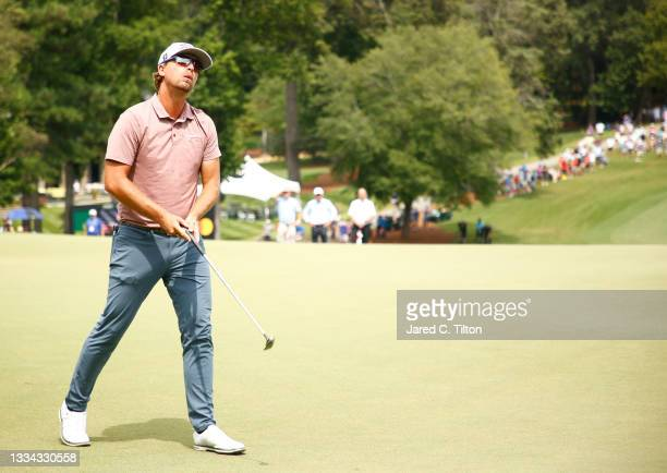 Roger Sloan of Canada reacts after missing a putt for birdie on the 18th green, the first-playoff hole in a six-way sudden-death playoff, during the...