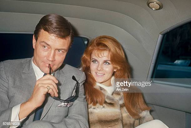 Roger Smith with sun glasses and AnnMargret in the back of a limo circa 1970 New York