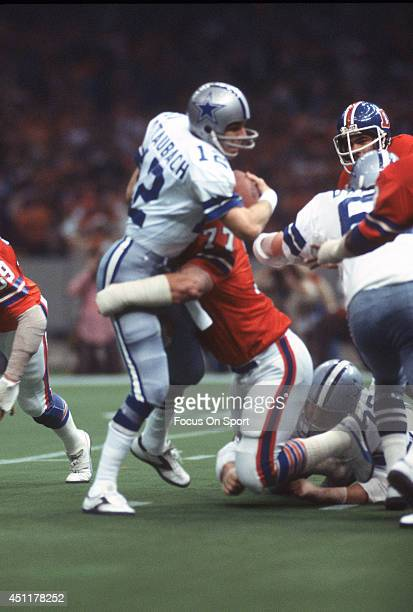 Roger Staubach of the Dallas Cowboys gets tackled by Lyle Alzado of the Denver Broncos during Super Bowl XII on January 15 1978 at the Louisiana...