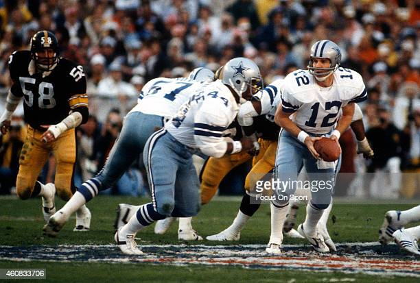 Roger Staubach of the Dallas Cowboys turns to hand the ball off to a running back against the Pittsburgh Steelers during Super Bowl XIII on January...