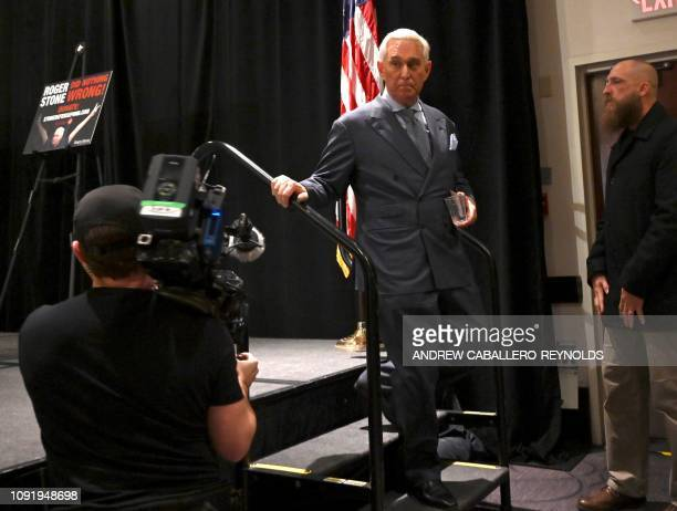 Roger Stone ally of US President Donald Trump leaves after speaking to the press in Washington DC on January 31 2019 Stone pleaded not guilty on...