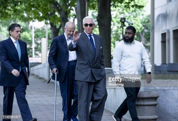 Roger Stone former adviser to Donald Trump's presidential campaign second right waves while arriving at federal court in Washington DC US on Tuesday...