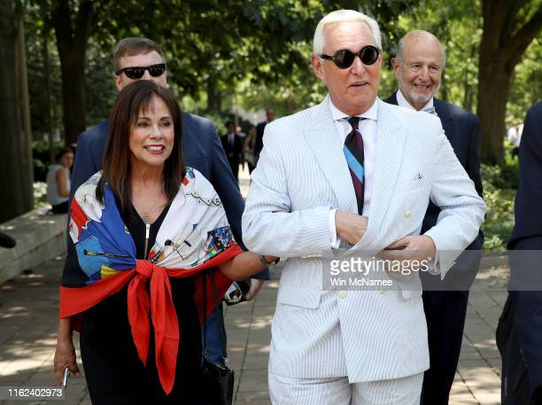 Roger Stone former adviser to US President Donald Trump departs the E Barrett Prettyman United States Court House with his wife Nydia July 16 2019 in...