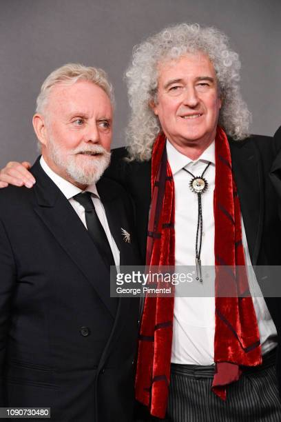 Roger Taylor and Brian May of Queen pose in the press room during the 75th Annual Golden Globe Awards held at The Beverly Hilton Hotel on January 06...