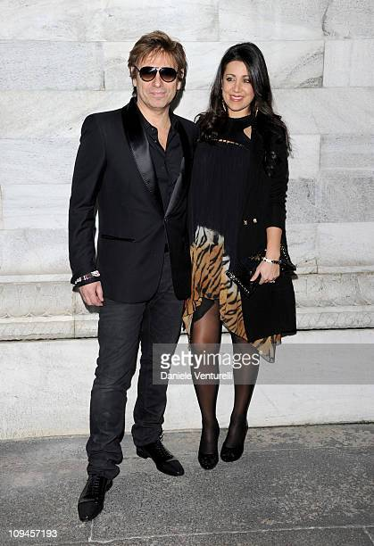 Roger Taylor and Gisella Bernales attend the Roberto Cavalli fashion show as part of Milan Fashion Week Womenswear Autumn/Winter 2011 on February 26...