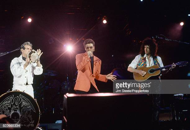 Roger Taylor drummer for Queen George Michael and Brian May guitarist for Queen performing on stage during the Freddie Mercury Tribute Concert for...