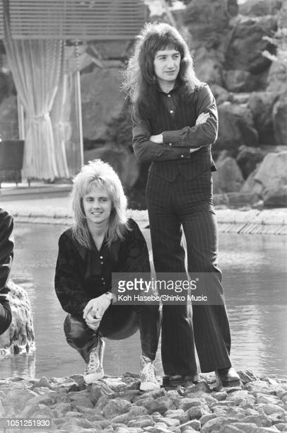 Roger Taylor John Deacon of Queen photo session for 'Music Life' magazine in the garden of Hotel Pacific Tokyo on their Night At The Opera Japan tour...