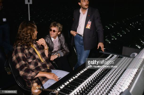 Roger Taylor of Queen by a mixing desk during a rehearsal at Nippon Budokan Tokyo Japan February 1981