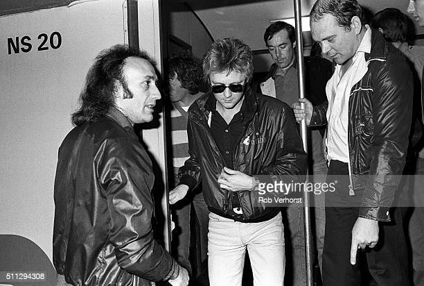 Roger Taylor of Queen with manager Jim Beach on a train from Leiden to Amsterdam Netherlands after a gig at Groenoordhal Leiden 25th April 1982