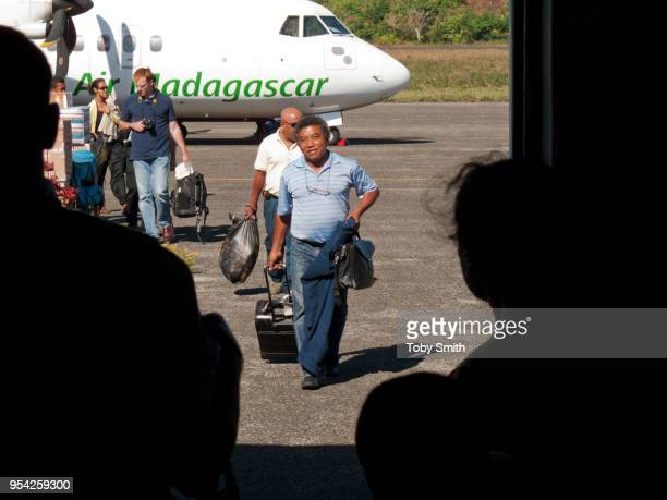 Roger Thuman a Malagasi trader of prescious timber disembarks from a plane that has arrived in Antalaha in the Sava region He is alleged to be the...