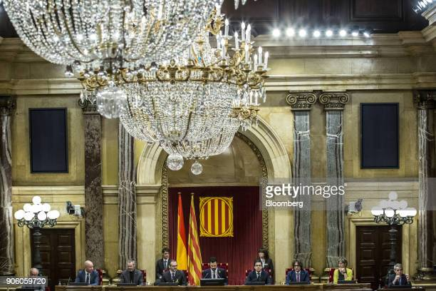 Roger Torrent lawmaker with Esquerra Republicana de Catalunya center sits with fellow parliamentary board members after being invested as the new...