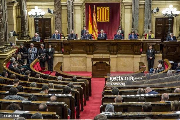 Roger Torrent new president of the Catalan parliament center sits with fellow parliamentary board members from left Joan Garcia Eusebi Campdepadros...