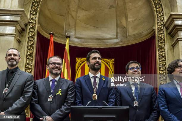 Roger Torrent new president of the Catalan parliament center stands before lawmakers with fellow parliamentary board members from left Eusebi...