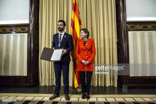 Roger Torrent newly elected president of the Catalan parliament left stands besides Carme Forcadell former president of the Catalan parliament...