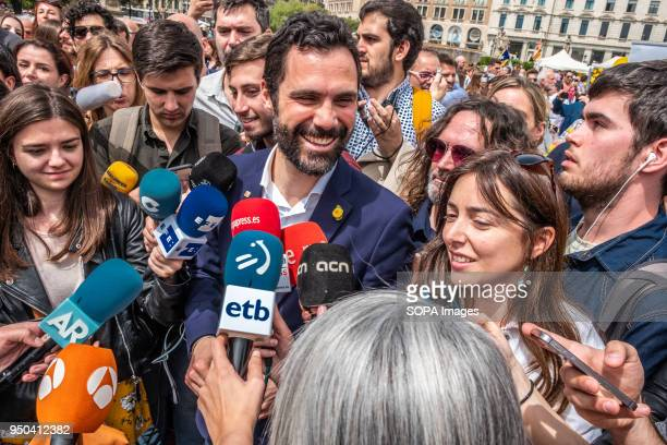 Roger Torrent president of the Catalan Parliament table is seen talking to the press a few steps from the yellow roses mural Catalunya celebrates the...