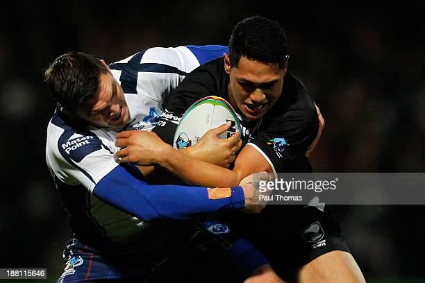 Roger TuivasaSheck of New Zealand is tackled by Danny Brough of Scotland during the Rugby League World Cup Quarter Final match between New Zealand...