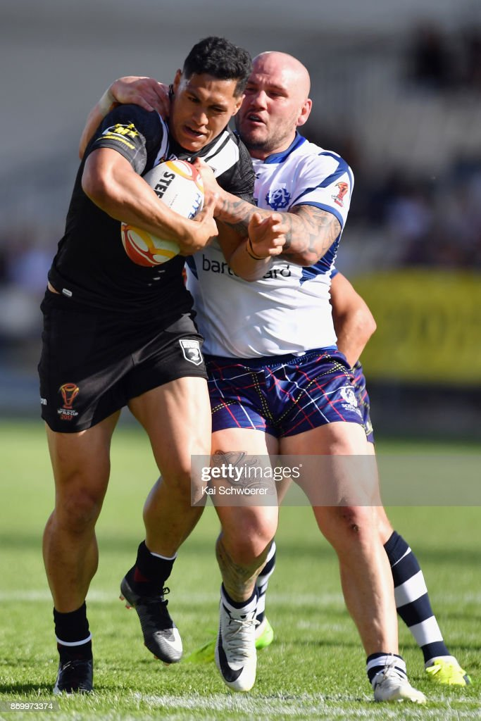 Roger Tuivasa-Sheck of the Kiwis is tackled by Dale Ferguson of Scotland during the 2017 Rugby League World Cup match between the New Zealand Kiwis and Scotland at AMI Stadium on November 4, 2017 in Christchurch, New Zealand.