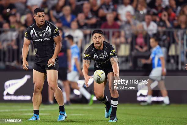 Roger Tuivasa-Sheck of the Kiwis looks on as Shaun Johnson of the Kiwis passes the ball during the Rugby League Test match between the New Zealand...