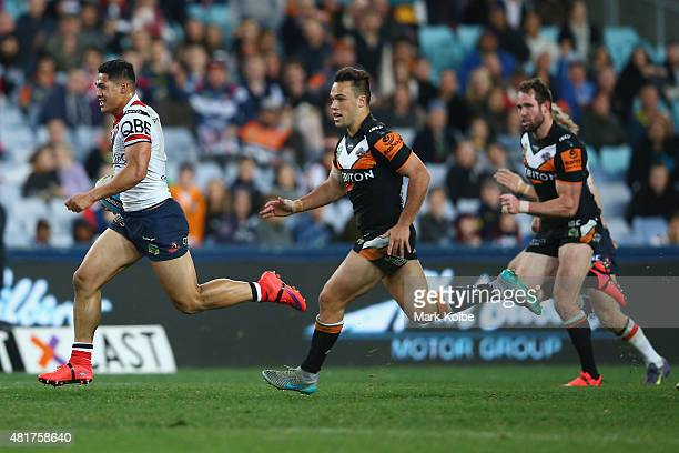 Roger TuivasaSheck of the Roosters makes a break during the round 20 NRL match between the Wests Tigers and the Sydney Roosters at ANZ Stadium on...