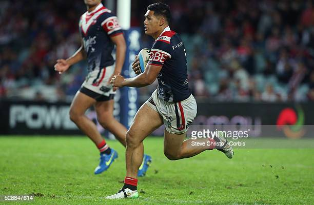 Roger Tuivasa-Sheck of the Roosters makes another run against the Dragons during their ANZAC day clash at Allianz Stadium. Sydney, Australia....