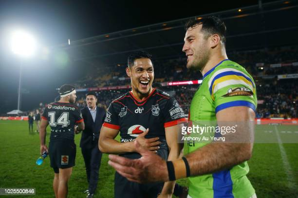 Roger TuivasaSheck of the Warriors catches up with Michael Oldfield of the Raiders after the round 25 NRL match between the New Zealand Warriors and...