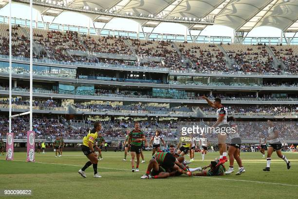 Roger TuivasaSheck of the Warriors celebrates a try during the round one NRL match between the South Sydney Rabbitohs and the New Zealand Warriors at...