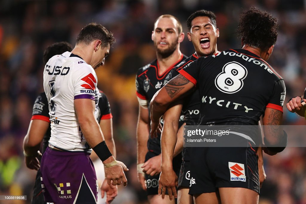 Roger Tuivasa-Sheck of the Warriors celebrates after a knock on from Billy Slater of the Storm with James Gavet of the Warriors during the round 19 NRL match between the New Zealand Warriors and the Melbourne Storm at Mt Smart Stadium on July 22, 2018 in Auckland, New Zealand.