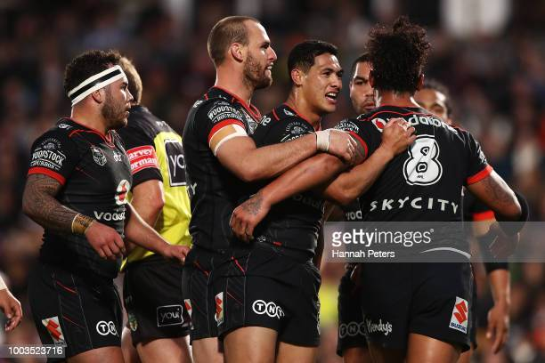 Roger TuivasaSheck of the Warriors celebrates after a knock on from Billy Slater of the Storm with James Gavet of the Warriors during the round 19...