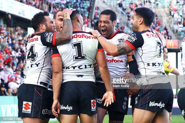 Roger TuivasaSheck of the Warriors celebrates with his team mates after a try saving tackle on Tim Lafai of the Dragons during the round 21 NRL match...