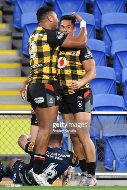 Roger Tuivasa-Sheck of the Warriors celebrates with team mates after scoring a try during the round nine NRL match between the Gold Coast Titans and...