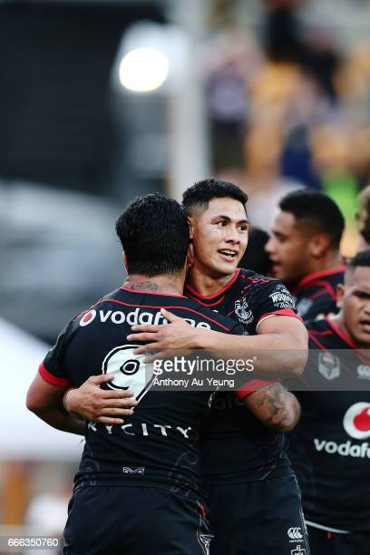Roger TuivasaSheck of the Warriors celebrates with teammate Issac Luke after Ken Maumalo's try during the round six NRL match between the New Zealand...