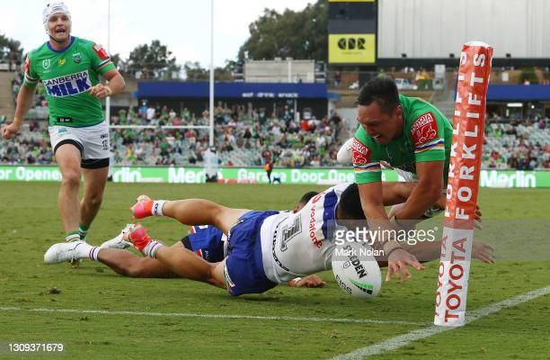 Roger Tuivasa-Sheck of the Warriors denies Jordan Rapana of the Raiders a try with a desperate diving tackle on full time during the round three NRL...