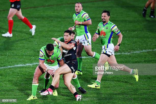 Roger TuivasaSheck of the Warriors is brought down during the round 23 NRL match between the New Zealand Warriors and the Canberra Raiders at Mt...