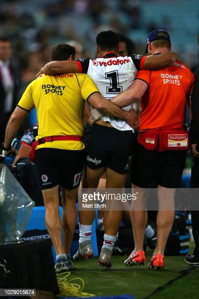 Roger TuivasaSheck of the Warriors is helped off the field after an injury during the NRL Elimination Final match between the Penrith Panthers and...